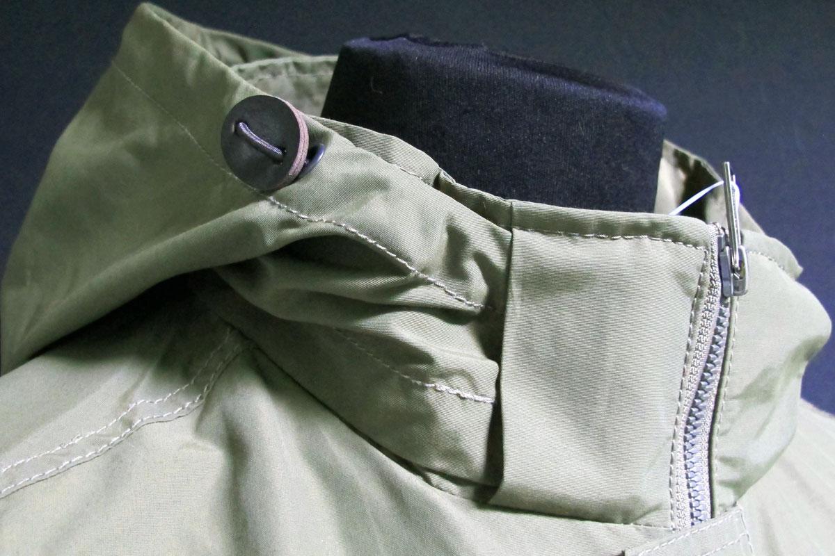 Detail of spring man jacket, green AK EUROPE